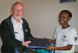 Cliff presenting one of our college students, Eskedar, with a laptop to help her in her education.