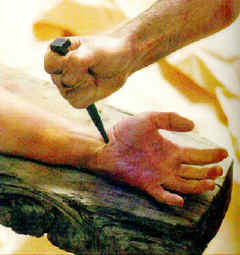 Jesus' hand being nailed