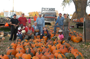 pumpkins and workers at pay station
