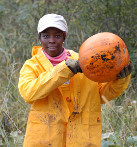 woman holding up pumpkin