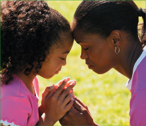 Mother and daughter praying