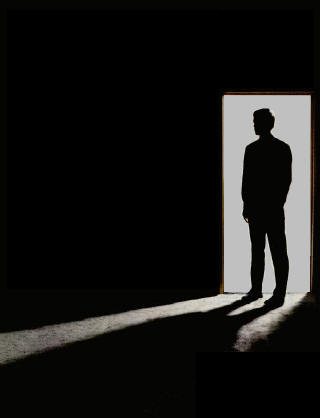 silhouette of a man in a doorway