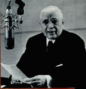 Herbert Armstrong at a microphone