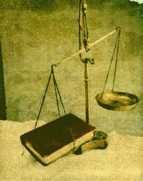 a balance with a Bible on one side